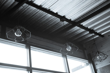 Industrial pendant lamps. The interior of the loft style. Gray background.