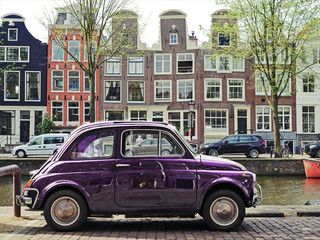 Travel to Amsterdam on a retro car.
