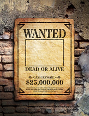 Wanted poster on brick wall