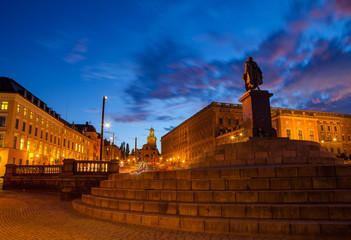 Scenic summer night view of statue and royal palace. Stockholm, Sweden.