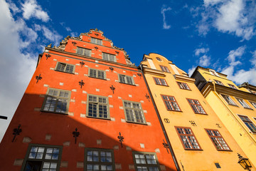 Colorfull old houses of old town of Stockholm - Stortorget, popular touristic attraction. Sweden