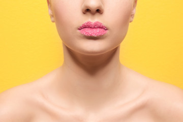 Woman with sugar lips on color background