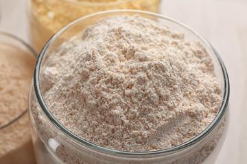 Glass jar with rye flour, closeup