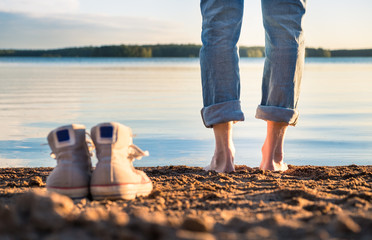 Man standing in beach at nice summer evening in Finland.