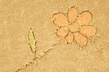 flower drawing in sand