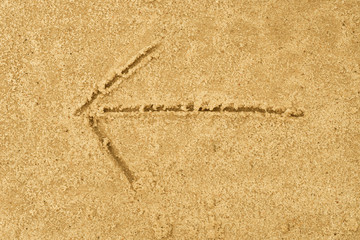 arrow sign drawing in sand