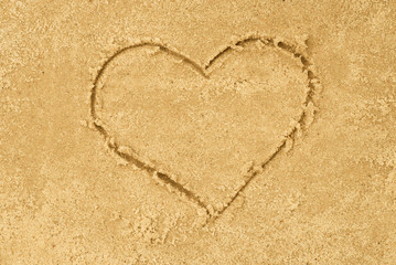 heart shape drawing in sand