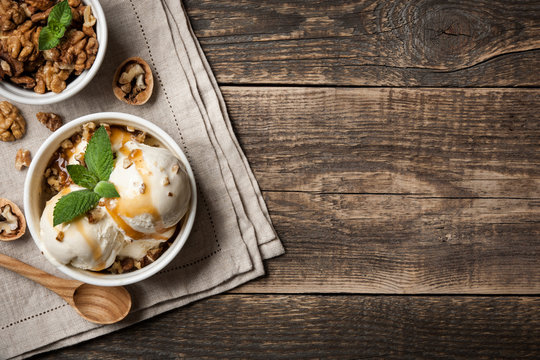 Vanilla ice cream with nuts and caramel sauce