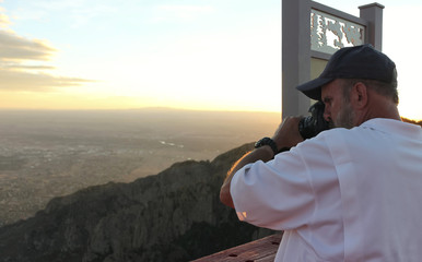 A Photographer on the Sandia Peak Aerial Tramway Observation Deck at Sunset