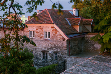 sunrise over old Tallinn. Top view on a medieval building from the observation deck of the Danish garden. Historical landmark of Estonia. Early morning in the summer.