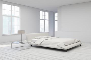 Yellow bed, white floor corner