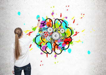 Blond woman drawing brain with cogs