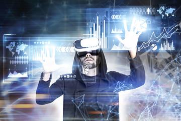 Bearded guy in VR glasses, diagrams