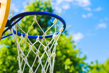 Basketball ring on blue sky background