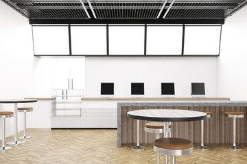 Modern cafe with computers and a fridge