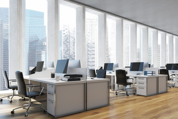 Workplace in an open space office, side