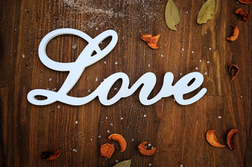 Love text card on wooden backdrop
