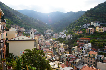 Panoramic view from the center of Riomaggiore with mountains on the background, Riomaggiore, Cinque Terre, Italy