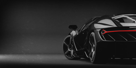 Generic black sports car (with grunge overlay), tail lights detail - 3d illustration