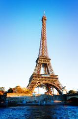 Eiffel Tower over Seine river in soft sunset light, Paris, France, retro toned