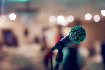 Microphone in concert hall or conference room with defocused bokeh lights in background. Extremely shallow dof. : Vintage style and filtered process