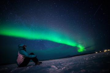 Girl watching the Northern Lights. Abisko Sweden