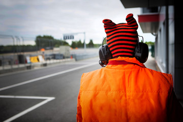 Motorsport track marshall orange racing bib close up with out