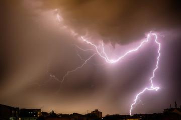 Thunderhead and Lightning Over City