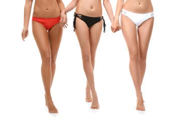 Beautiful young women in bikini on white background