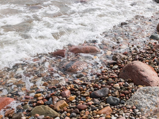 Rocky seashore covered with waves