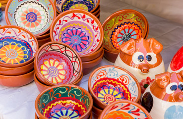 Colorful ceramic bowls at the tourist market of Valencia