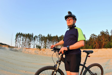 the cyclist with the bike in a sand pit.