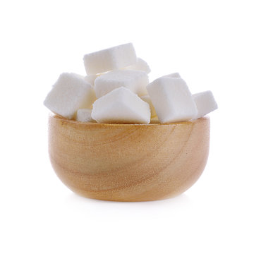 sugar cube in wooden bowl on white background