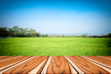 Selected focus empty brown wooden table and blue sky or mountain blur background with bokeh image. for your photomontage or product display