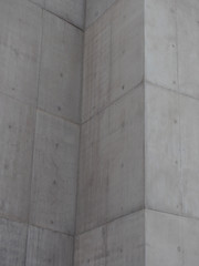 grey concrete walls with block markings and angled corners