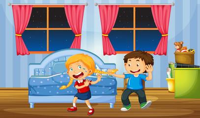 Brother teasing sister in bedroom