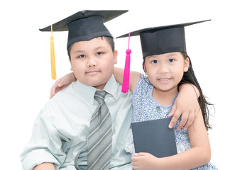 handsome boy and cute girl with graduate cap