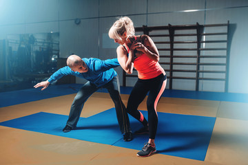 Woman in actoin on self-defense training