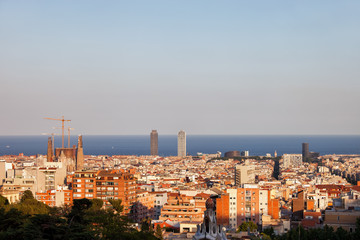 Barcelona cityscape at sunset, horizon of Mediterranean Sea, Catalonia, Spain