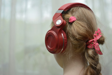 Girl in headphones view from behind and side