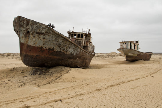 """Old ships in the desert """"ship cemetery"""" the consequence of Aral sea disaster, Muynak, Uzbekistan"""
