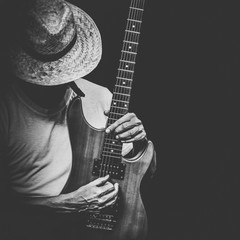 male artist playing electric guitar, black and white