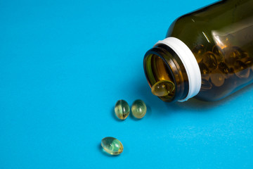 Fish oil capsules in glass bottle.