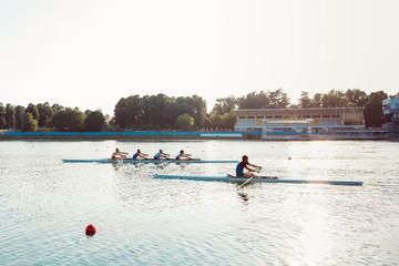 Rowers on lake