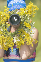 Photographer on a flower meadow