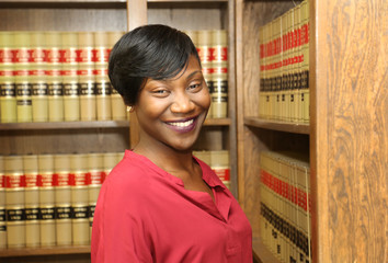 Portrait of attractive young African American female lawyer, law office