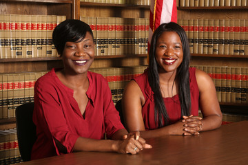 Two attractive young African American female lawyers, law office
