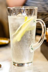 Lemonade cucumber sweaty glass decanter.