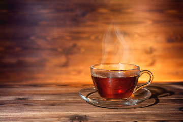 cup of tea on dark wooden background, close up