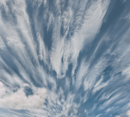 Dramatic fast moving clouds over blue sky on sunny day.  Abstract clouds.